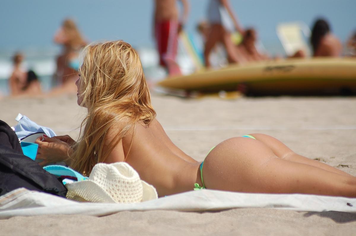 Topless girl beach